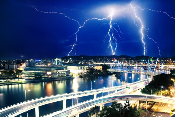 Multiple eletric lightning strikes over river in Brisbane